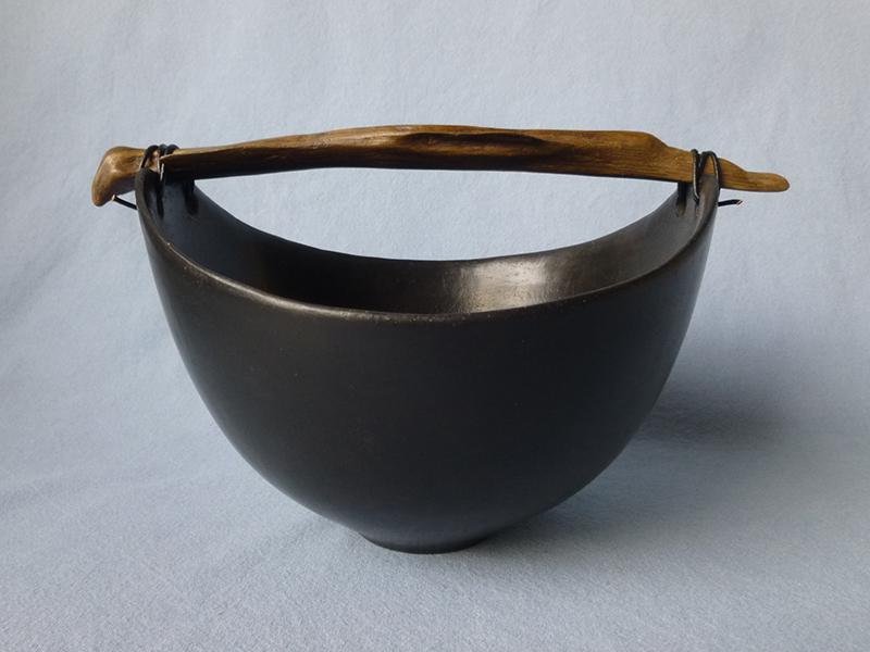 Anne Morrison. Black bowl with dark wood