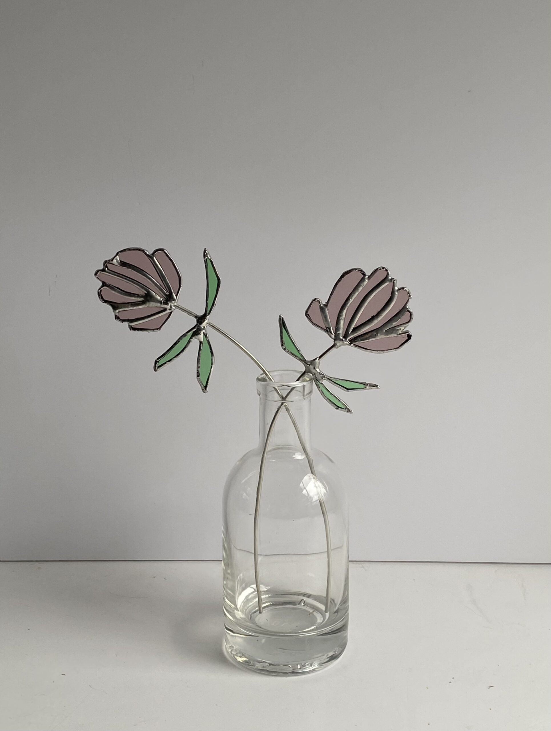 Stained glass flowers of clover by Samantha Yates.