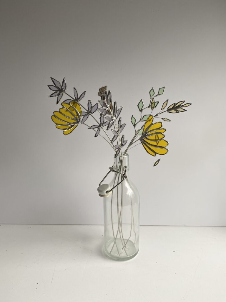 Glass and metal flowers in yellow by Samantha Yates