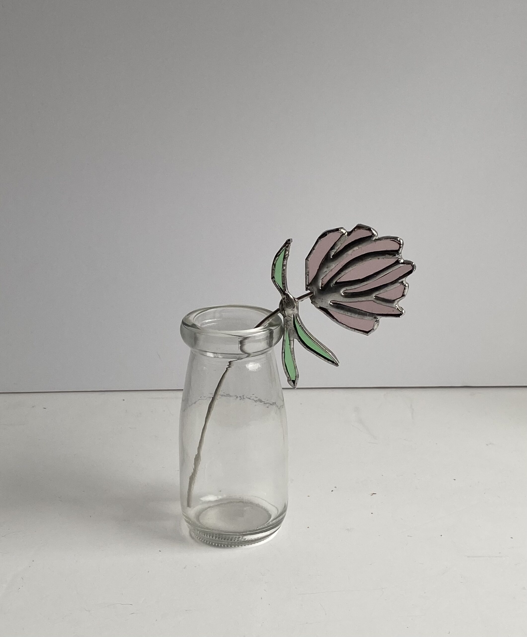 Stained glass flower of clover by Samantha Yates.